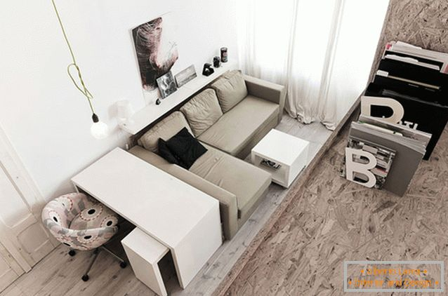 Living room of a two-storey studio apartment in Poland