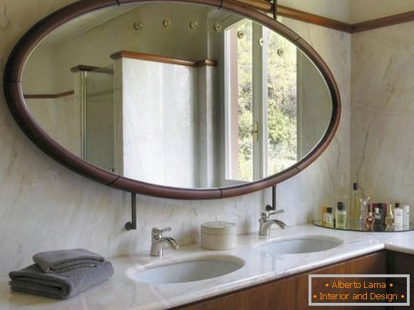 Large oval mirror in the bathroom