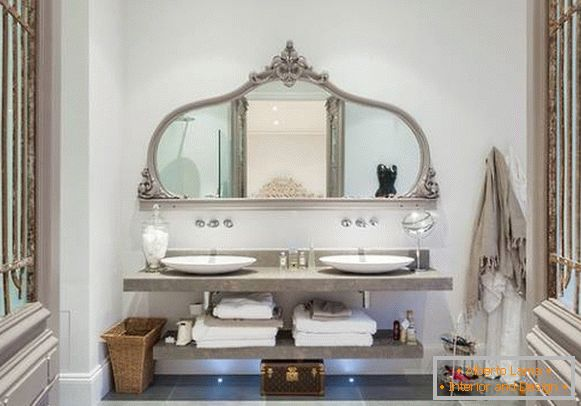 Elegant large mirror with shelves in the bathroom