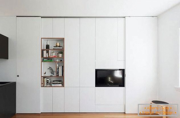 Modular wall in the interior of the apartment also divides the space